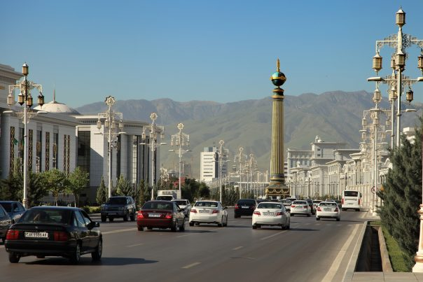 Ashgabat, Turkmenistan - Circa June 2013: Vew on the Wide modern boulevard Turkmenbashi with beautiful monument in Ashgabat (capital of Turkmenistan) Circa June 2013.